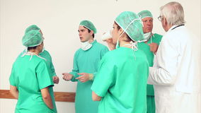 Surgery team speaking to each other Stock Images