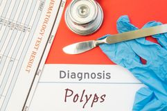 Surgical diagnosis of Polyps. Surgical medical instrument scalpel, latex gloves, blood test analysis lie close beside text inscrip. Tion diagnosis of Polyps Stock Photo