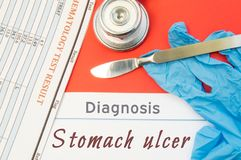 Surgical diagnosis of Stomach Ulcer. Surgical medical instrument scalpel, latex gloves, blood test analysis lie close beside text. Inscription diagnosis of Stock Photography