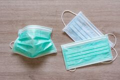 Surgical face masks for preventing covid-19 disease on wooden background
