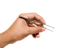 Surgical forceps. Forceps being held by a hand isolated on a white background Royalty Free Stock Photography