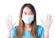 Surgical glove. Nurse showing her surgical glove on  white background Stock Image