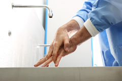 Surgical hand disinfection. The doctor washes his hands, disinfect their hands before surgery royalty free stock photos