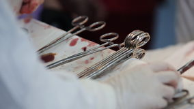 Surgical instruments contaminated with blood on the table in the operating room. close-up. Surgical instruments on a table in the operating room stock video