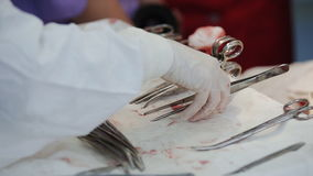 Surgical instruments on a table in the operating room. Surgical instruments contaminated with blood on the table in the operating room. close-up stock footage