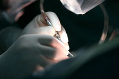 Surgical Operation. Focus on hand Stock Image