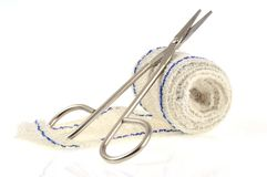 Surgical scissors and bandage stock image