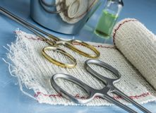 Surgical Scissors On A Bandage. Conceptual Image Royalty Free Stock Photo
