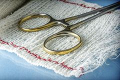 Surgical Scissors On A Bandage. Conceptual Image Stock Images