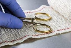Surgical Scissors On A Bandage, Conceptual Image. Conceptual image Royalty Free Stock Image