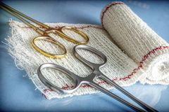 Surgical Scissors On A Bandage. Conceptual Image Stock Photo