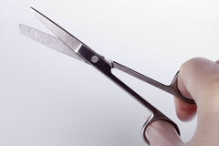 Surgical scissors. In the hands of the surgeon Royalty Free Stock Images