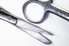 Surgical scissors. Sharp steel scissors on a white background Stock Photos