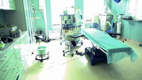 Surgical team getting ready for surgery in hospital operating room stock footage