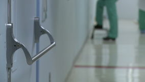 Surgical team walking outside operating room stock footage