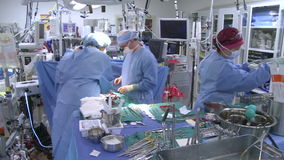 Surgical team at work (8 of 10) stock video footage