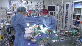 Surgical team at work (7 of 10) stock video