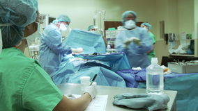 Surgical Team Working In Operating Theatre