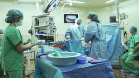 Surgical Team Working In Operating Theatre stock video