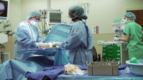 Surgical Team Working In Operating Theatre stock footage