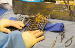 Surgical technician preparing instruments for an operation. royalty free stock photo