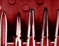Surgical tools illuminated by the red light Stock Photography