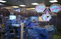 Surgical work in the operating theatre of modern hospital royalty free stock photography