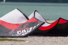 A surging kite lying on a beach in the lake of Santa Croce Stock Photos