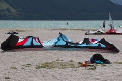 A surging kite lying on a beach in the lake of Santa Croce Royalty Free Stock Images