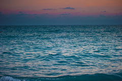Surging sea at dawn and gloomy sky Stock Photography