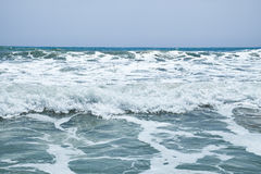 The surging waves of the Mediterranean on the beautiful beach Valencia in the summer sunny day. Royalty Free Stock Image