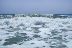 The surging waves of the Mediterranean on the beautiful beach Valencia in the summer sunny day. Royalty Free Stock Photography