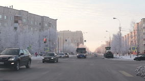 Surgut - November 15: Car traffic in winter city. The city at the crossroads in winter riding machine stock footage