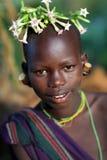 Suri flicka med blommor Royaltyfri Bild