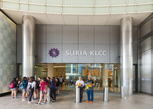 Suria KLCC shopping mall, Kuala Lumpur, Malaysia. KUALA LUMPUR - JUNE 15, 2016: Unidentified people stand by a lateral portal of the Suria KLCC. The shopping Stock Images