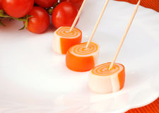 Surimi and cherry tomatoes Royalty Free Stock Images