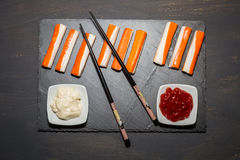 Surimi. On a dark table Stock Photography