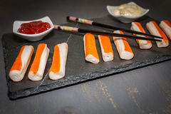 Surimi. On a dark table Royalty Free Stock Photography