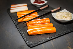 Surimi. On a dark table Royalty Free Stock Photos