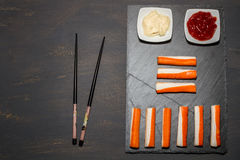 Surimi. On a dark table Stock Images