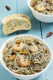 Surimi elvers with prawns, garlic and pepper Royalty Free Stock Photos