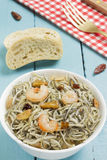 Surimi elvers with prawns, garlic and pepper Stock Photos