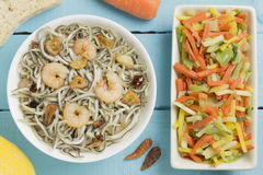 Surimi elvers with prawns, garlic and pepper Stock Image