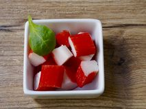 Surimi in a recipe. On wood background Stock Photo