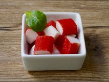 Surimi in a recipe. On wood background Royalty Free Stock Photo