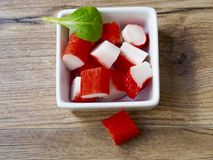 Surimi in a recipe. On wood background Royalty Free Stock Image