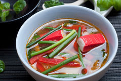 Surimi soup. East style surimi (kanikama) soup with rice noodles and chives Stock Photos