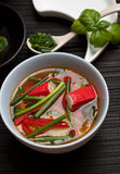 Surimi soup. East style surimi (kanikama) soup with rice noodles and chives Stock Photography