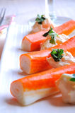 Surimi sticks with sauce on a white plate closeup Stock Photography