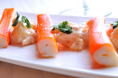 Surimi sticks with sauce on a white plate front view Royalty Free Stock Images